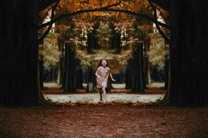 Girl Running in Woods