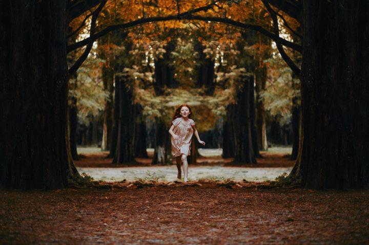 Girl Running in Woods